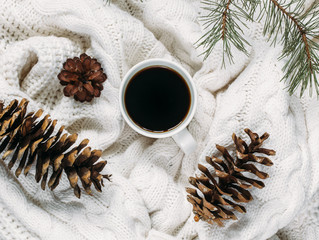 New Year's background. coffee and Christmas toys and warm scarves.