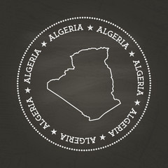 White chalk texture vintage seal with People's Democratic Republic of Algeria map on a school blackboard. Grunge rubber seal with country map outline, vector illustration.