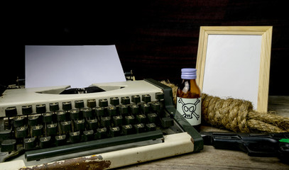 Obraz Typewriter with paper page and poison and gun. Concept writer Ro - fototapety do salonu