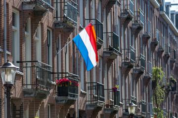 Dutch flag on a Amsterdam house on Kingsday