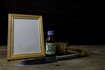 Picture frame and poison and knife. Concept Romance Suspense