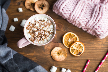 winter still life: hat, gloves, hot chocolate with marshmallows