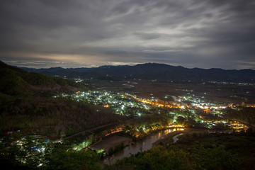 Thaton village illuminated at night, view from above. Chiang Mai province, Northern Thailand. Thai-Myanmar border.