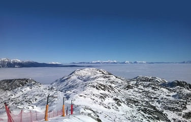 Fototapete - The top of Vogel Ski Centre with fog in valley, Slovenia