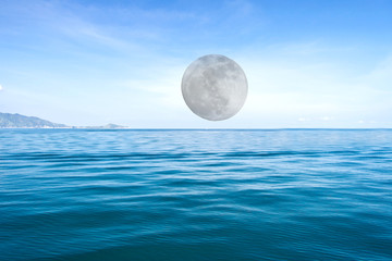 Big moon on blue sea waves surface abstract background pattern