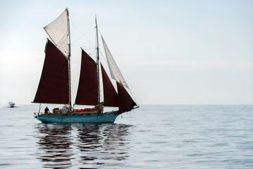 boat sailing sail ship in the blue sea