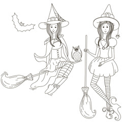 Two little witches with brooms.