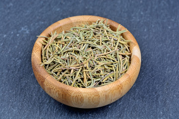 Dry rosemary in a bamboo bowl