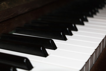 Close-up on an old ivory piano keyboard
