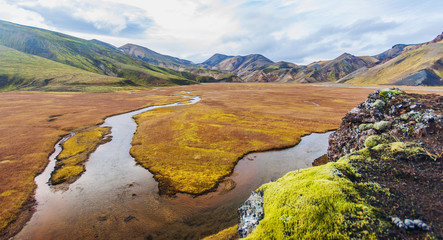 Valley National Park Landmannalaugar. On the gentle slopes of the mountains are snow fields and glaciers. Magnificent Iceland in autumn, fall