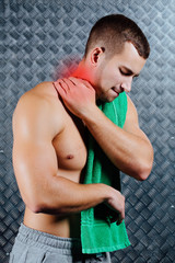 Strong fitness man feeling pain.