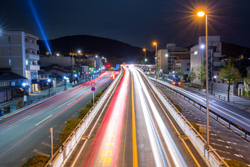 Traffic lights on the street of Kyoto city at night, Japan