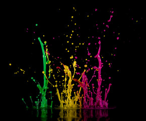 Аbstract sculptures of colorful splashes of paint. Dancing liquid on a black background. Ink water splash. Color explosion.