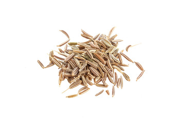 Close up pile of Cumin seeds isolated on white background