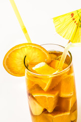 Close up orange cooler cocktail with drinking straw on white background