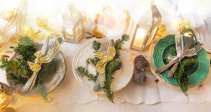 Christmas festive table setting decoration with tableware, ribbo