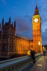 LONDON, ENGLAND - JUNE 16 2016: Night photo of Houses of Parliament with Big Ben from Westminster bridge, London, England, Great Britain