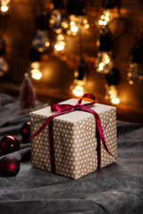 Christmas decoration and gift boxes over grey background.