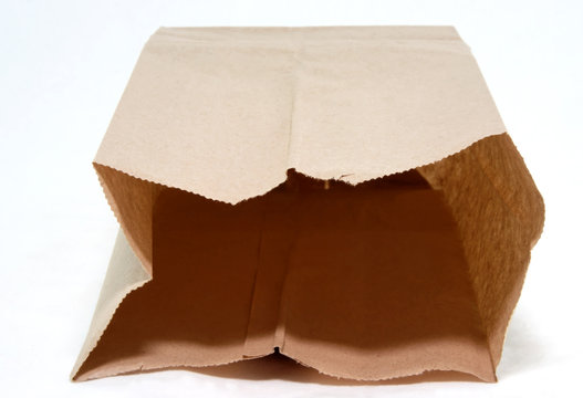 Open brown paper bag on white background. Front and top view. Horizontal.