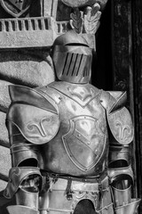 Medieval armor in front of a castle.