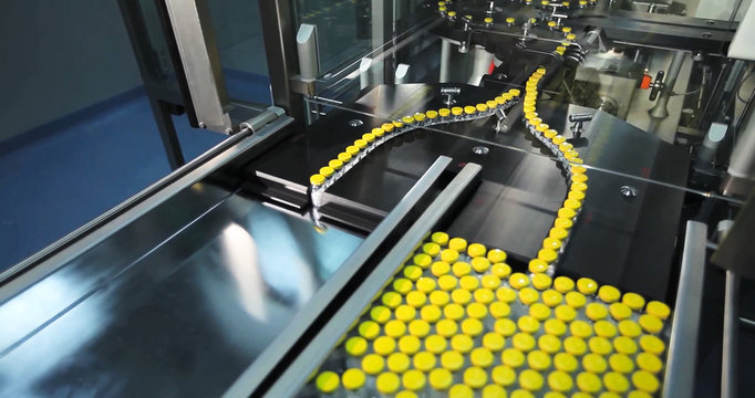 Automated line for marshalling bottles of drugs.