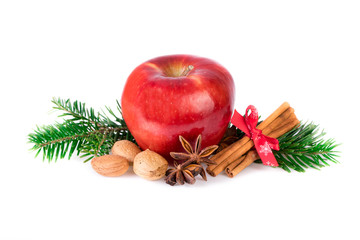 Red apple with christmas spices on white. Apple rustic still life.