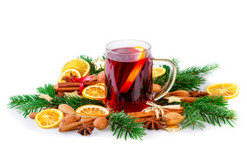 Mulled wine with christmas spices and fir branch on white