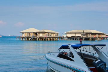 High speed yacht waiting for passengers / High speed yacht waiting for passengers and Thailand Pattaya city coast scenery