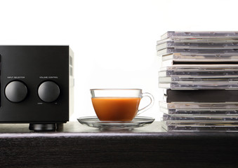 relax time / cup of coffee with amplifier and audio compact disc