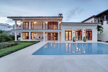 Spectacular Backyard Swimming Pool Designer home. Beautiful Exterior of New Home at Twilight.