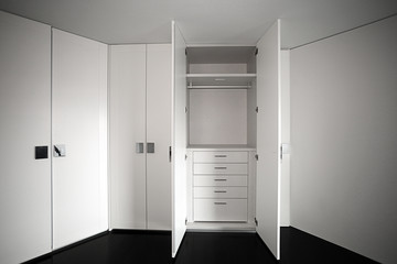 Empty designer closet, working closet with built-in wardrobe in a compact size.