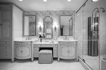 Luxury bathroom with double sink in black and white.