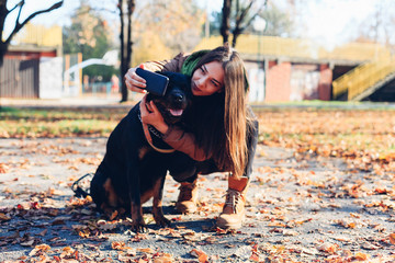 Girl taking selfie with her dog