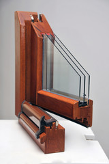 The cut wooden window profile with three glasses