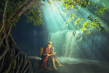 Asian woman at the waterfall, Thailand