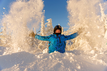 snowboarder having fun in a fantastic winter forest