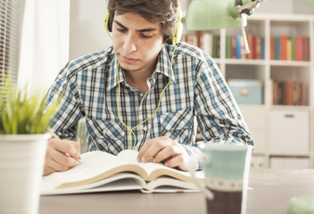 Portrait of young man reading book