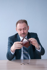 Male in a suit poured out of the bag last money