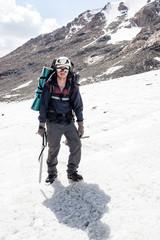 Hiker standing in crampons at mountains, Tien Shan, Kyrgyzstan.