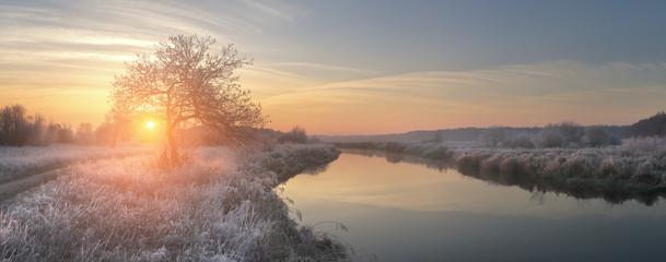 Panoramic view on winter sunrise