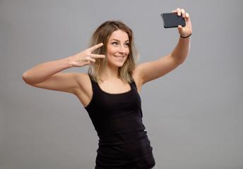 Young women making a selfie
