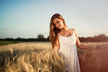 Beautiful woman in wheat meadow