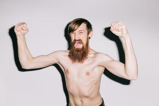 Portrait of a man on white studio background shouting