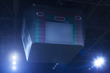 Scroreboard and spotlights in a basketball arena