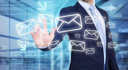 Businessman touching technology interface with email icons