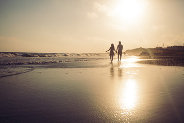 Young romantic couple at the coastline