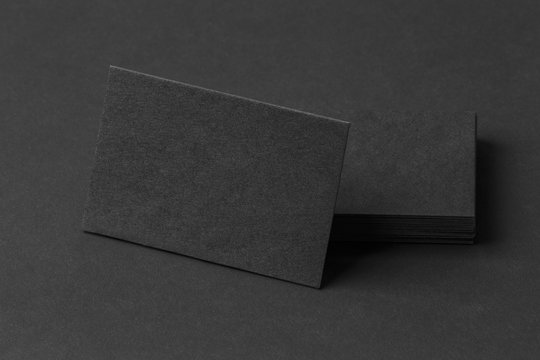 Photo of black business cards. Template for branding identity.