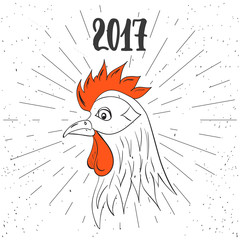 Christmas and New Year lettering calligraphy greeting card with 2017 year of the red fire rooster. Cock drawing on the illustration isolated on the white background with light rays.