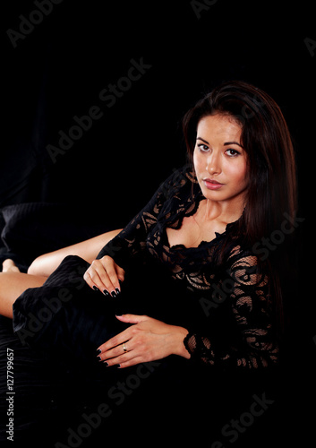 junge frau mit body im bett stock photo and royalty free images on pic 127799657. Black Bedroom Furniture Sets. Home Design Ideas