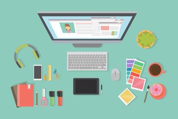 Designer desk mockup. Desk with computer screen, tablet and drawing tools.